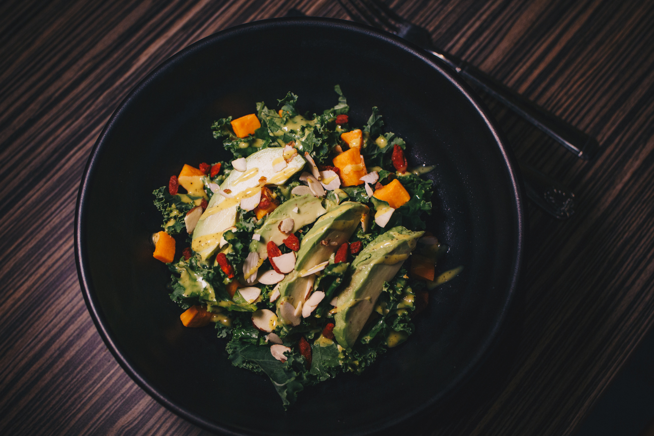 Lunch Detox Salad: kale, sweet potatoes, avocado, goji berry, tossed in a creamy turmeric dressing and garnished with shaved almonds / Image: Catherine Viox // Published: 4.22.19