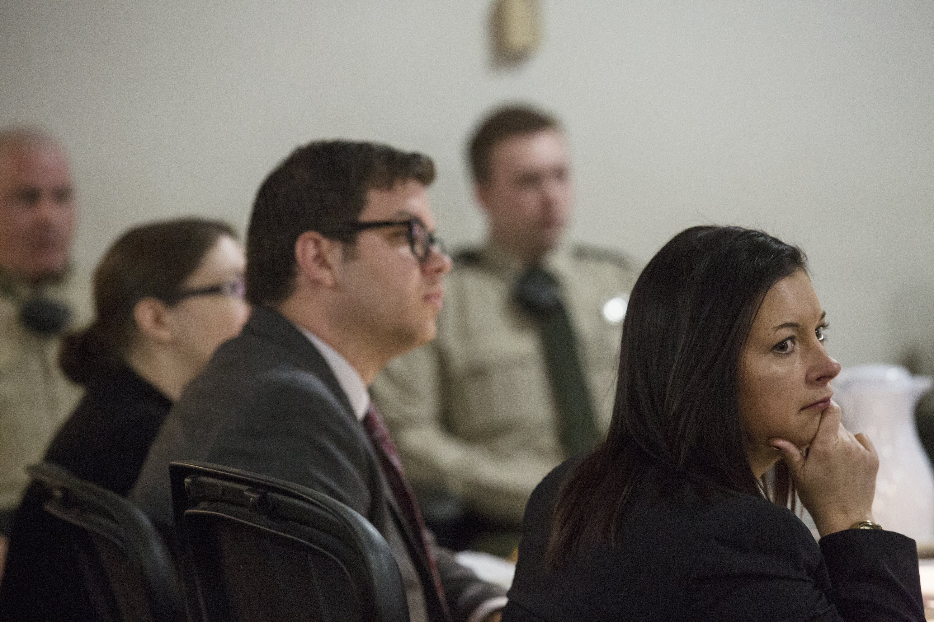 Defense Attorneys Thomas Augustine and Jennifer Larson listen to testimony during Nicole Finn's trial for murder, kidnapping and child endangerment on Wednesday, Dec. 6, 2017, at the Polk County Courthouse. (Kelsey Kremer /The Des Moines Register via AP, Pool)