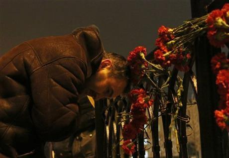 A man grieves outside the Volgograd main railway station in Volgograd, Russia early Monday, Dec. 30, 2013. A bomb blast tore through a trolleybus in the city of Volgograd on Monday morning, killing at least 10 people.
