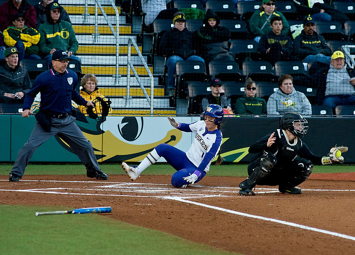 Huskies Ali Aguilar (#1) scores against the Ducks, the Huskies only run of the game. In Game Two of a three-game series, the University of Oregon Ducks softball team defeated the University of Washington Huskies 4-1 Friday night in Jane Sanders Stadium. Danica Mercado (#2), Alexis Mack (#10) and Mia Camuso (#7) all scored in the win, Mack twice. The Ducks play the Huskies for the tie breaker on Saturday with the first pitch at noon. Photo by Dan Morrison, Oregon News Lab