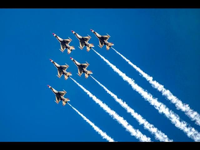 The U.S. Air Force Thunderbirds perform precision stunts during the Warriors Over the Wasatch Air Show on Hill Air Force Base, Utah, June 28, 2014.