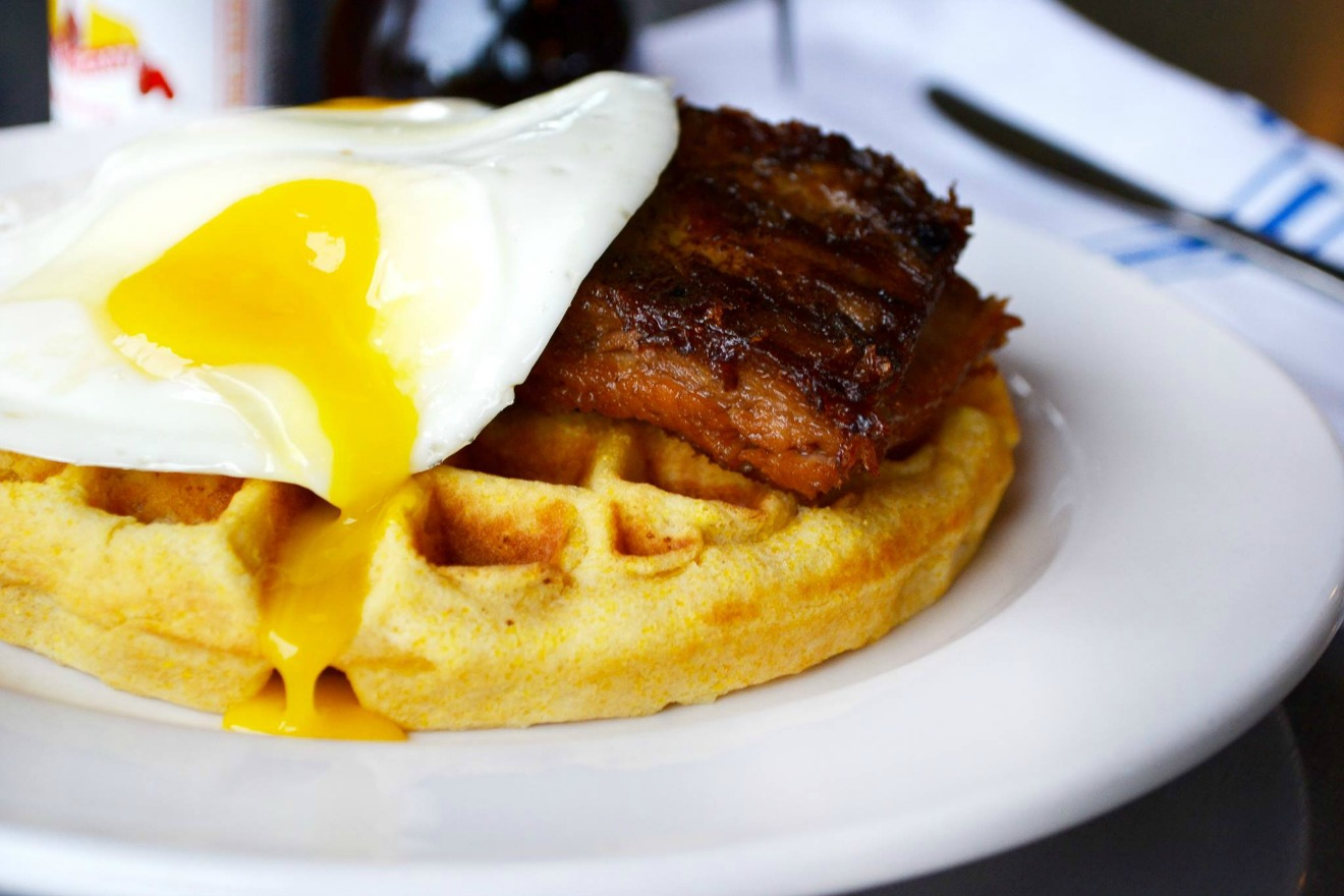 With three Seattle locations, Skillet is always a great choice for brunch. If you want a different take on chicken and waffles, try their cornmeal waffle served with maple braised pork belly. . (Image Courtesy: Skillet Facebook Page)