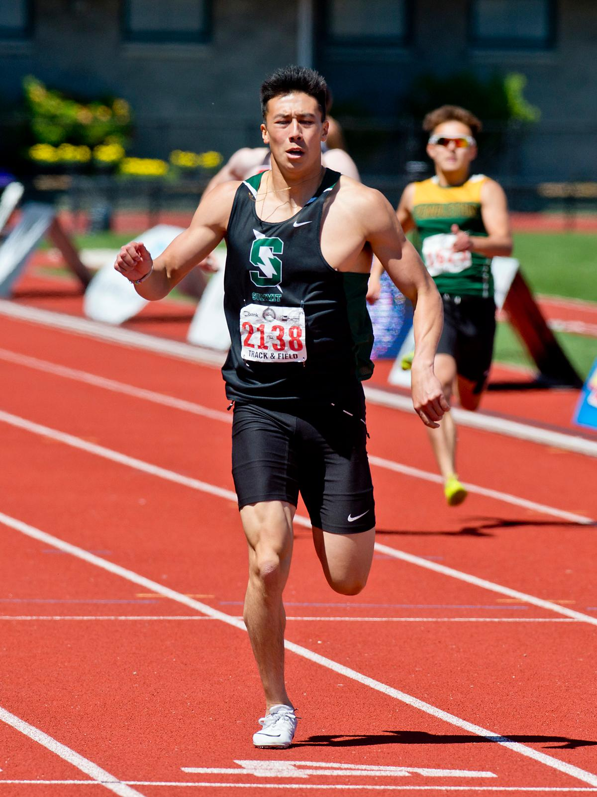 Brayden Durfee from Summit wins the 5A Boys 400 meter dash with a time of 49.22 at the OSAA Championship at Hayward Field on Saturday. Photo by Dan Morrison, Oregon News Lab