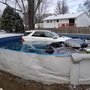 SUV goes off slick road and right into pool