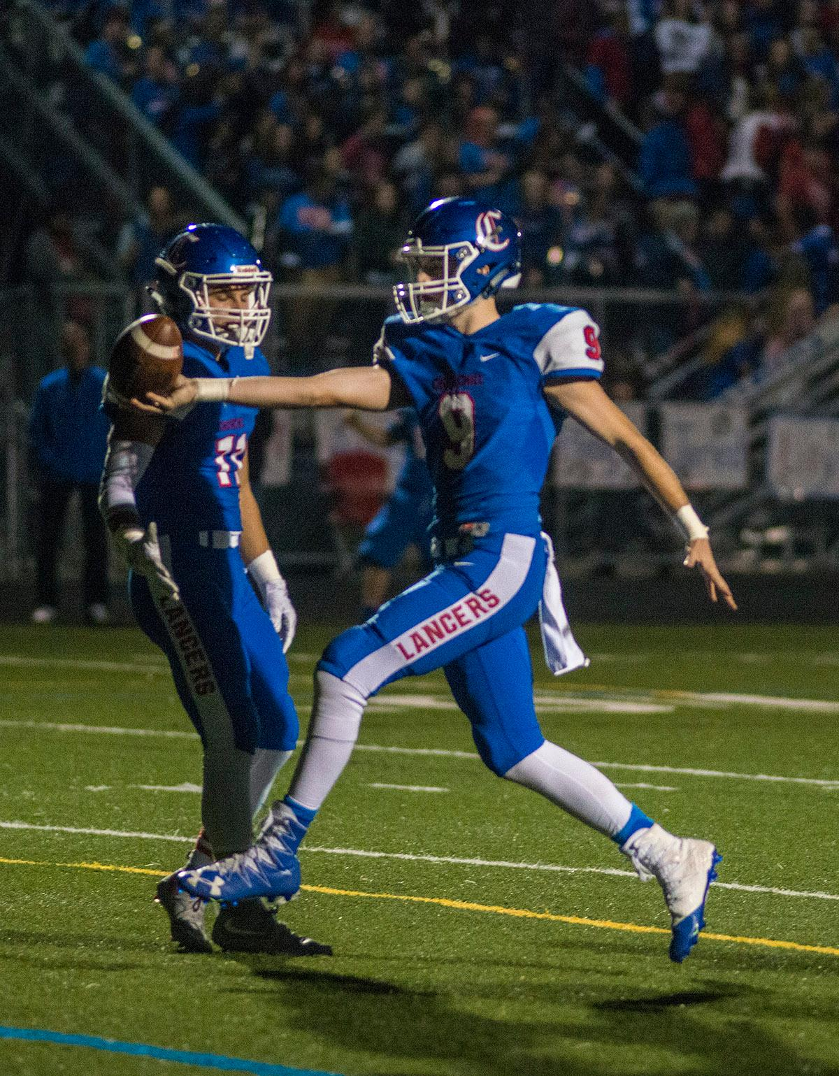 Churchill Lancers Jack Blackburn (#9) carries the ball into the end zone for a touchdown. Churchill defeated Crater 63-21 on Friday at their homecoming game. Churchill remains undefeated with a conference record of 9-0. Photo by Rhianna Gelhart, Oregon News Lab