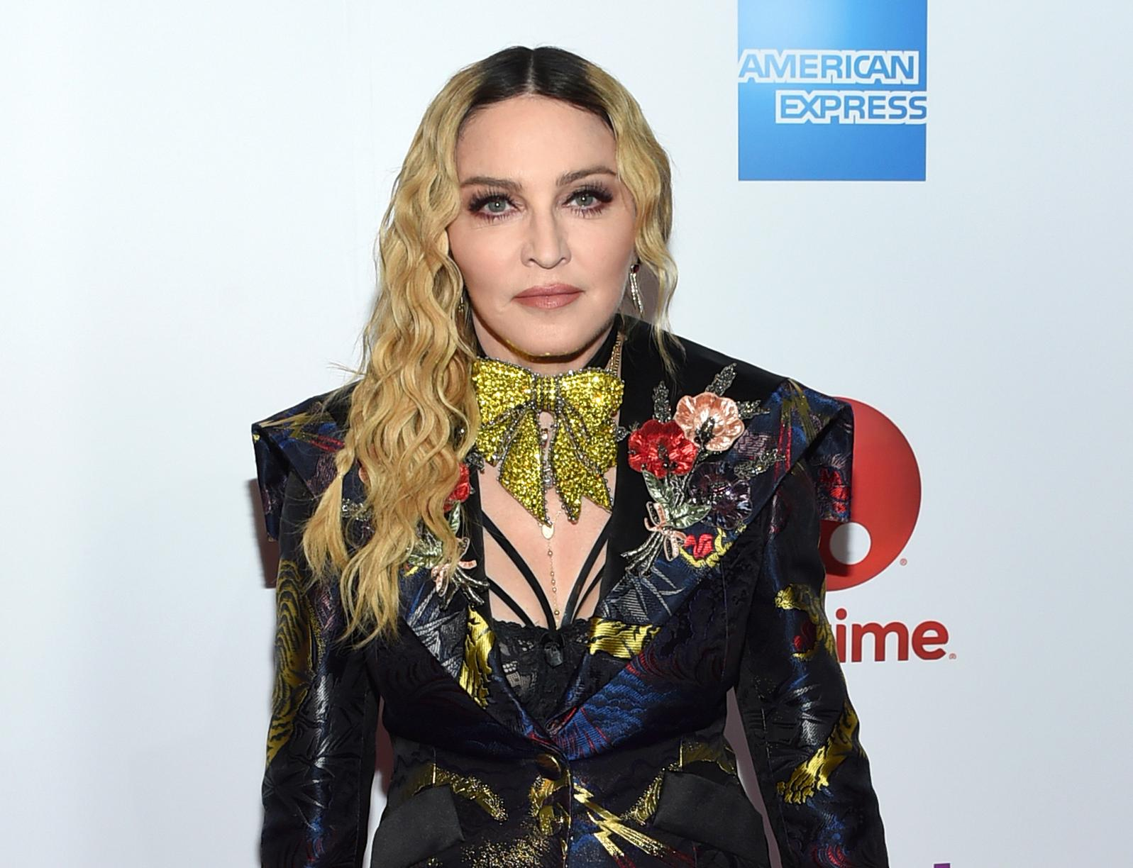 "FILE - This Dec. 9, 2016 file photo shows Madonna at the 11th annual Billboard Women in Music honors in New York. On Monday, the Hollywood Reporter announced that Universal had acquired the rights to ""Blond Ambition,"" a script about the singer. (Photo by Evan Agostini/Invision/AP, File)"
