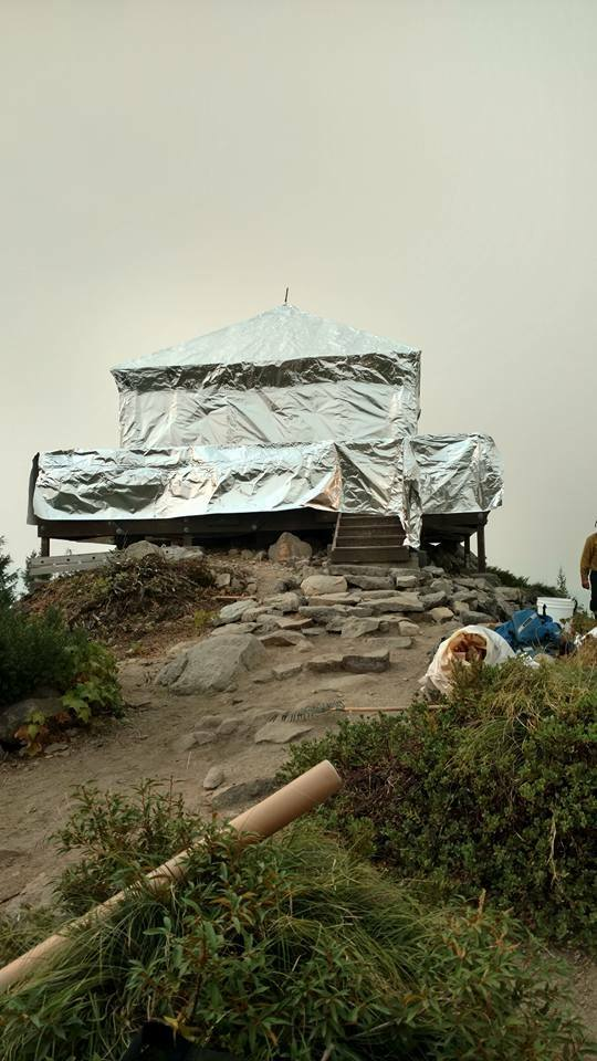 Firefighters spent 2 days wrapping the historic wooden structure in fire-resistant material to protect it from danger posed by the Scorpion Fire. (USDA Forest Service)