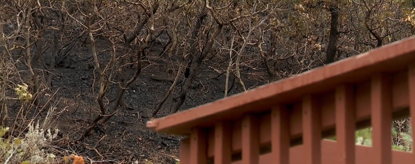 The fire came within feet of her home. Firefighters had to slash brush from around her porch to keep it from spreading. (KUTV)