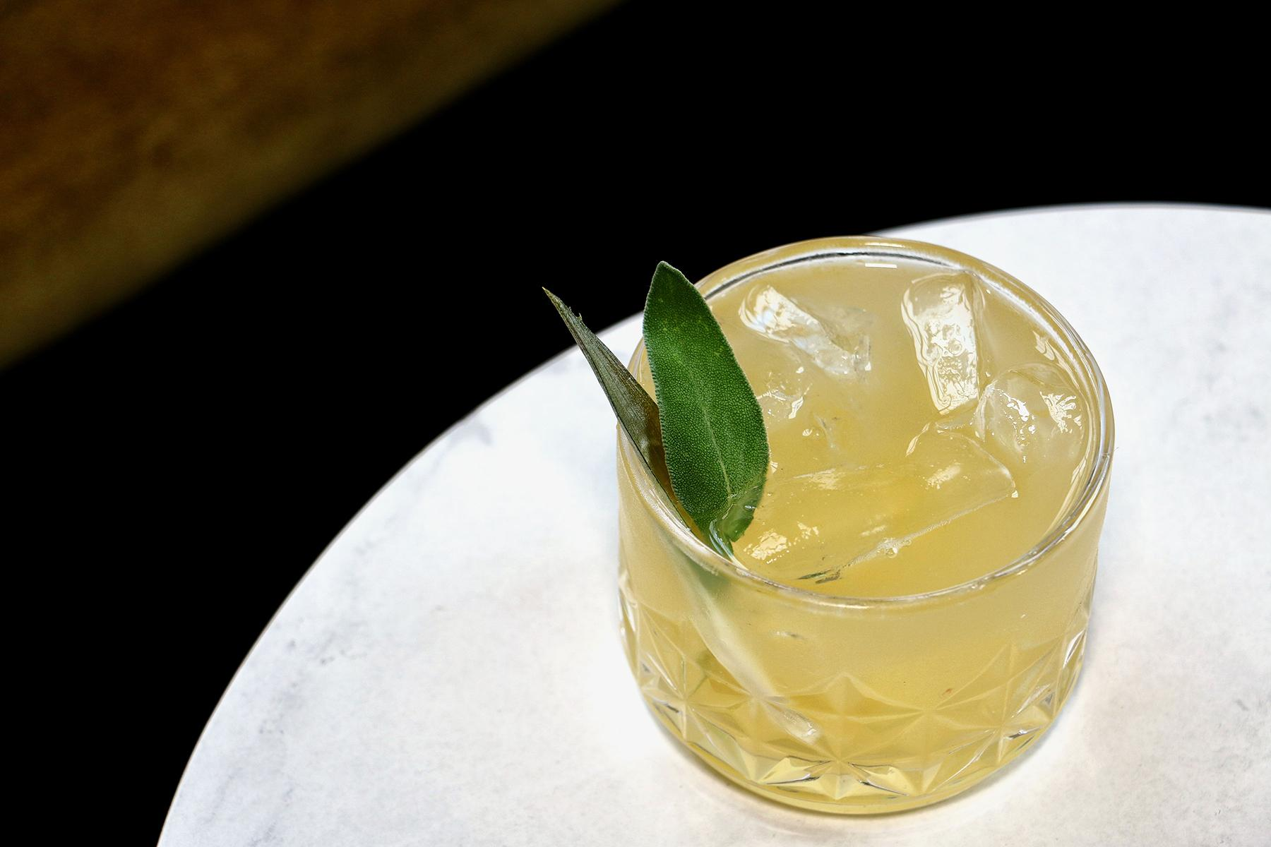"March of Time: A refreshing tangy effervescent tipple with Fords Gin, fermented pineapple soda, sage syrup and Persian lime. ""The gentle Lapsana, Nymphaea fair, and bright Calendula with golden hair, watch with nice eye the earth's diurnal way, making her solar and sidereal day, her slow mutation, and her varying climb, and trace with mimic art the march of time."" (Image: Jai Williams)"