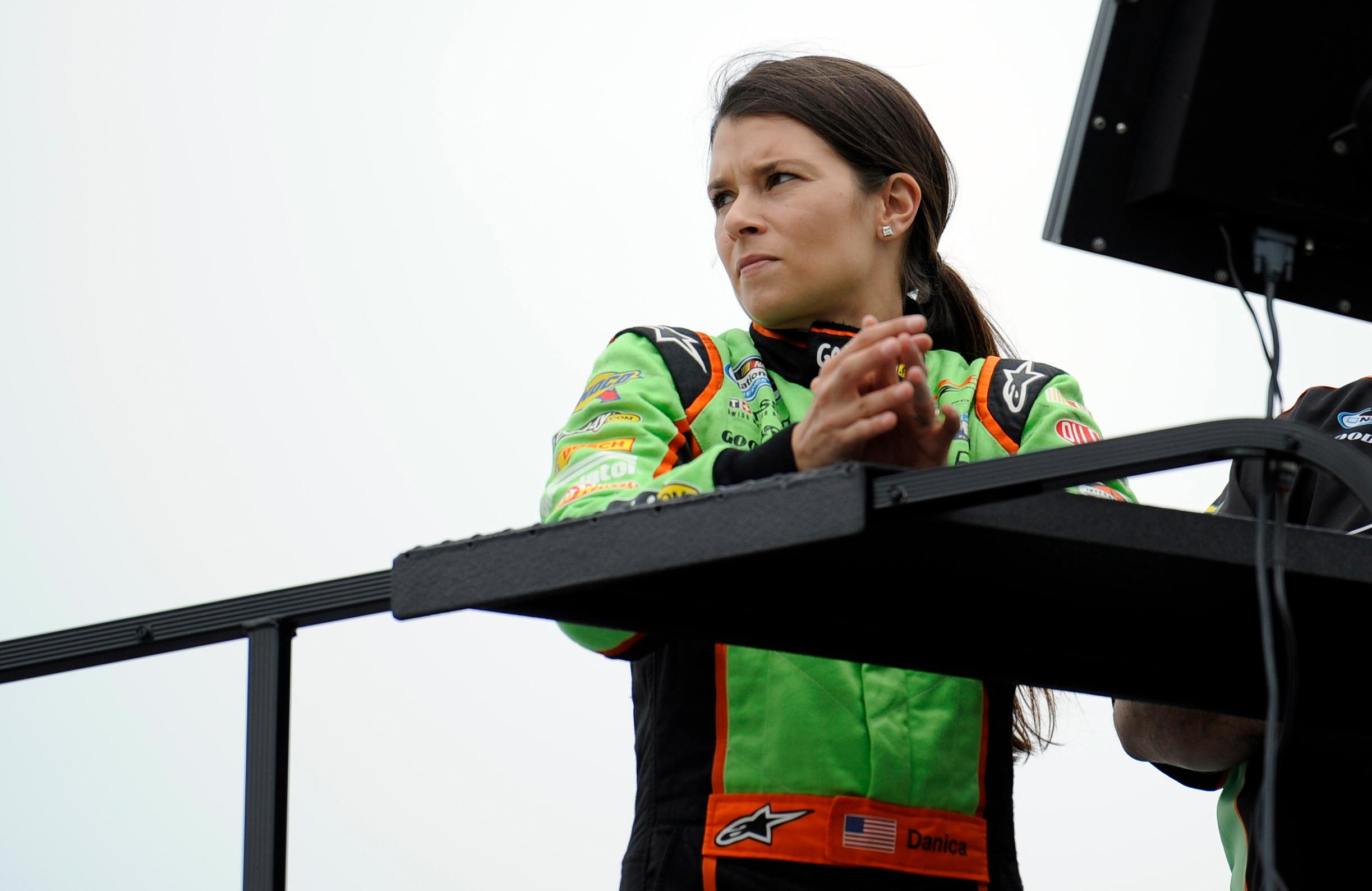 FILE - In this June 1, 2012, file photo, NASCAR Nationwide Series driver Danica Patrick watches from on top of her hauler in Dover, Del. Patrick announced plans Friday, Nov. 17, 2017, to run just 2 races in 2018, the Daytona 500 and the Indianapolis 500, and end her full-time driving career. (AP Photo/Nick Wass, File)