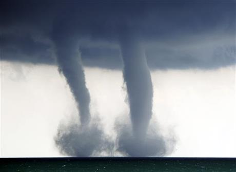 A pair of water spouts form on Lake Michigan southeast of Kenosha, Wis. on Thursday, Sept. 12, 2013.
