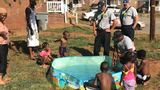Firefighters fill kiddie pool for little boy after spotting family using pots of water