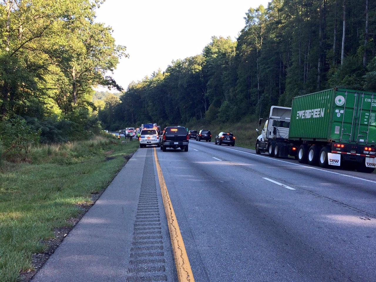 Highway Patrol confirms one person has died after a wreck along Interstate 26 WB, near Exit 37, on Thursday morning. (Photo credit: WLOS Staff)