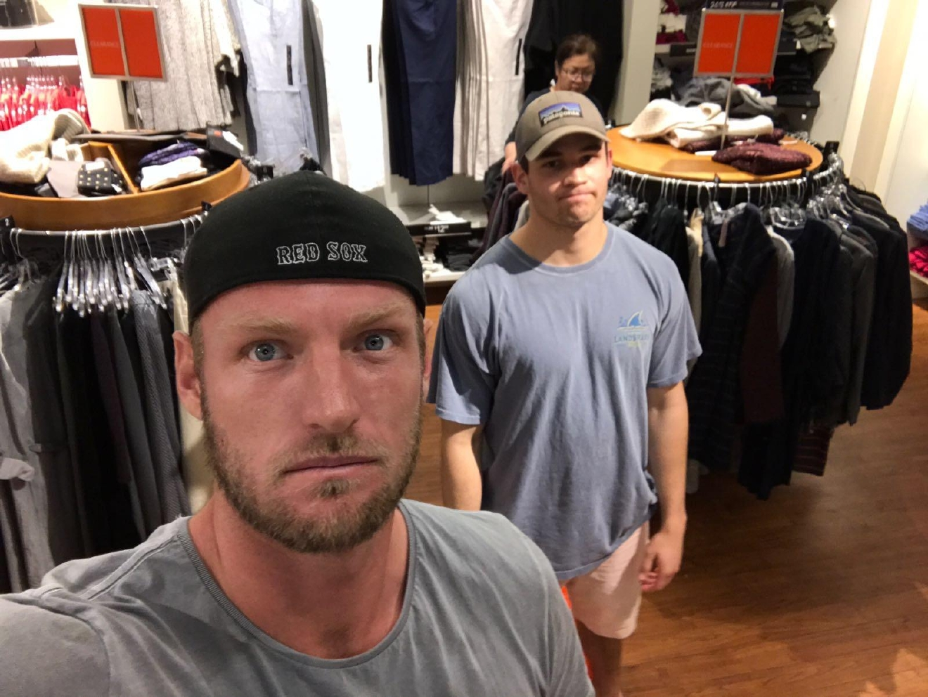 Sam snaps a photo with a friend while waiting for the girls to shop