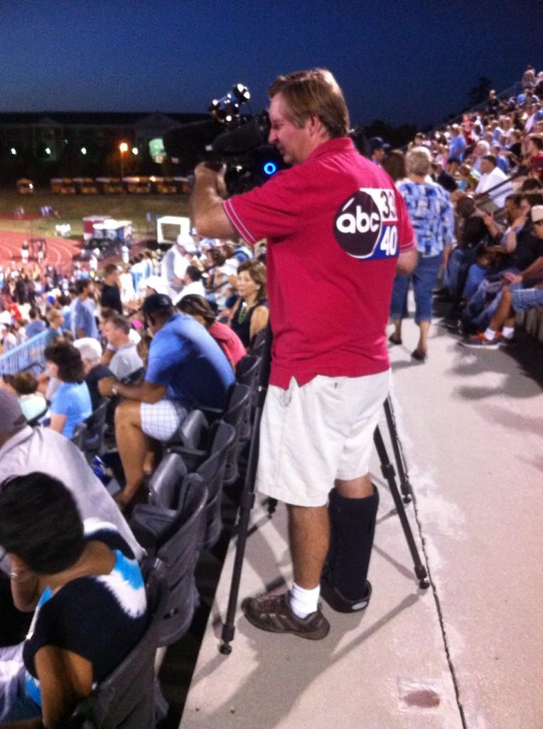 Injured ABC 33/40 photog John Rocket doesn't let his bum foot keep him from covering the Spain Park-Austin game Friday night, August 22, 2014.