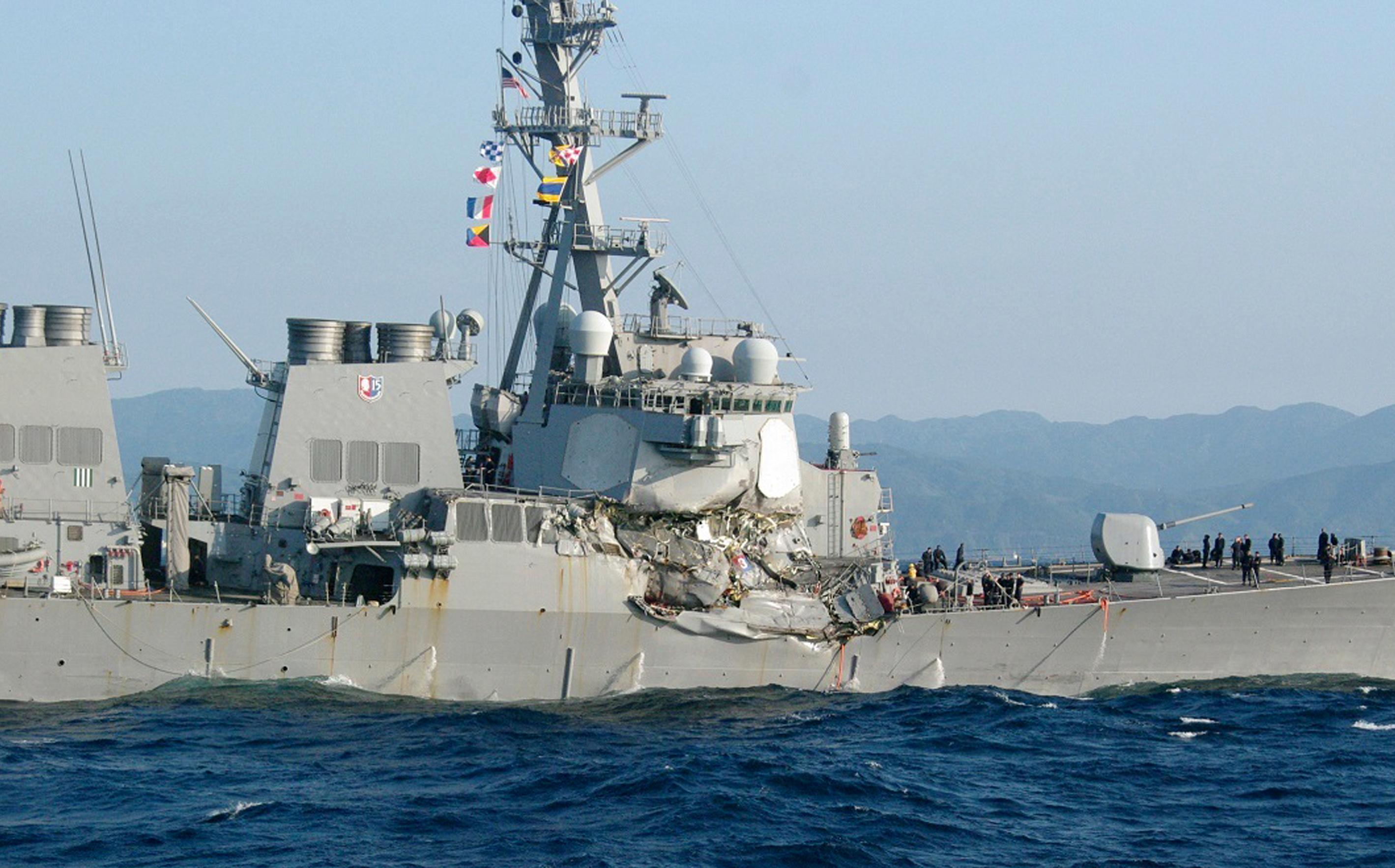 In this photo provided by Japan's 3rd Regional Coast Guard Headquarters, the USS Fitzgerald is seen off Izu Peninsula in, Japan, after the Navy destroyer collided with a merchant ship, Saturday,  June 17, 2017.  Seven Navy sailors were missing and at least two, including the captain, were injured after the U.S. destroyer collided with a merchant ship off the coast of Japan before dawn Saturday, the U.S. Navy and Japanese coast guard reported. (Japan's 3rd Regional Coast Guard Headquarters via AP)