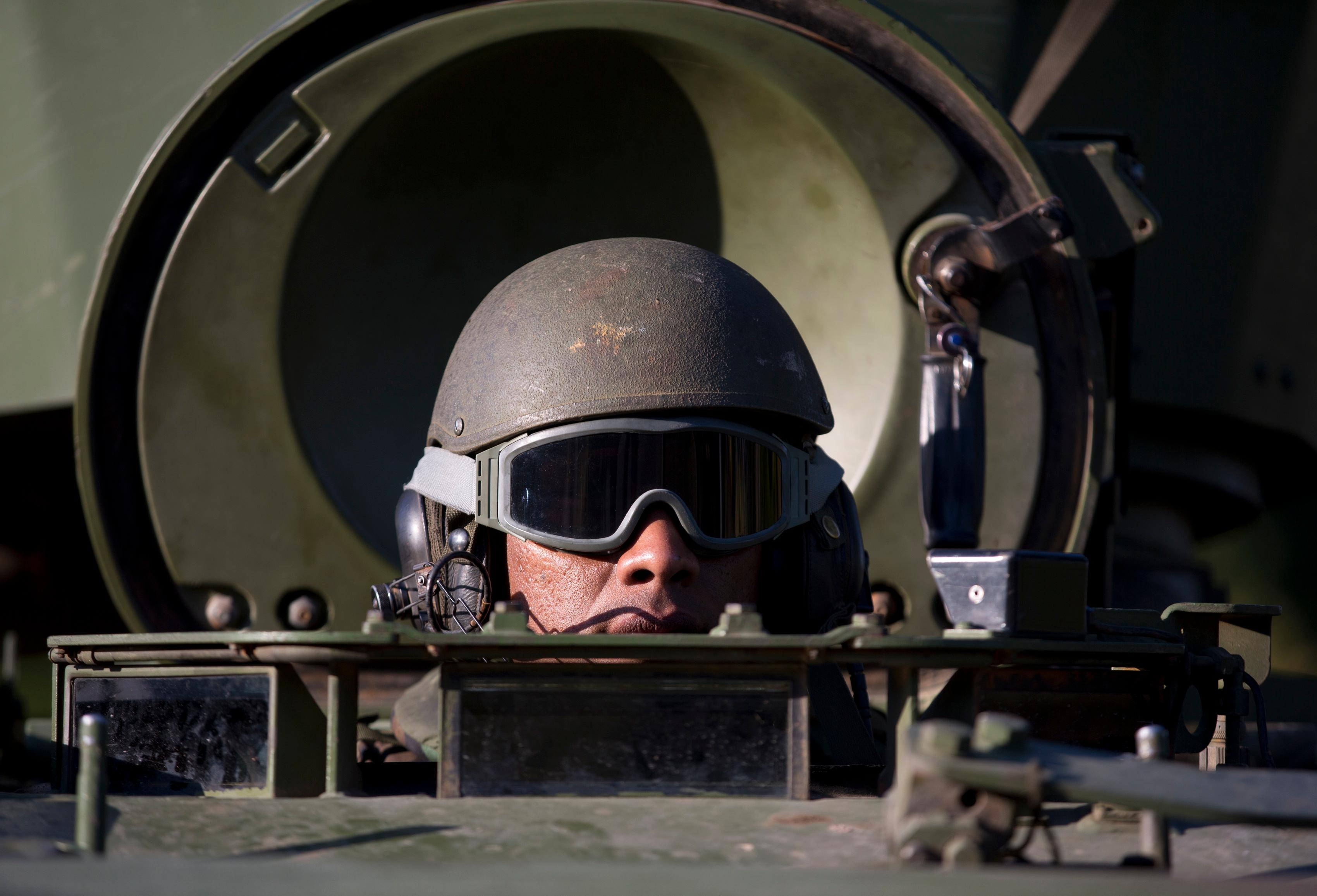 A Navy soldier patrols in an armored vehicle near Santos Dumont Airport in Rio de Janeiro, Brazil, Friday, July 28, 2017.  Thousands of Brazilian soldiers have begun patrolling in Rio de Janeiro amid a spike in violence. (AP Photo/Silvia Izquierdo)