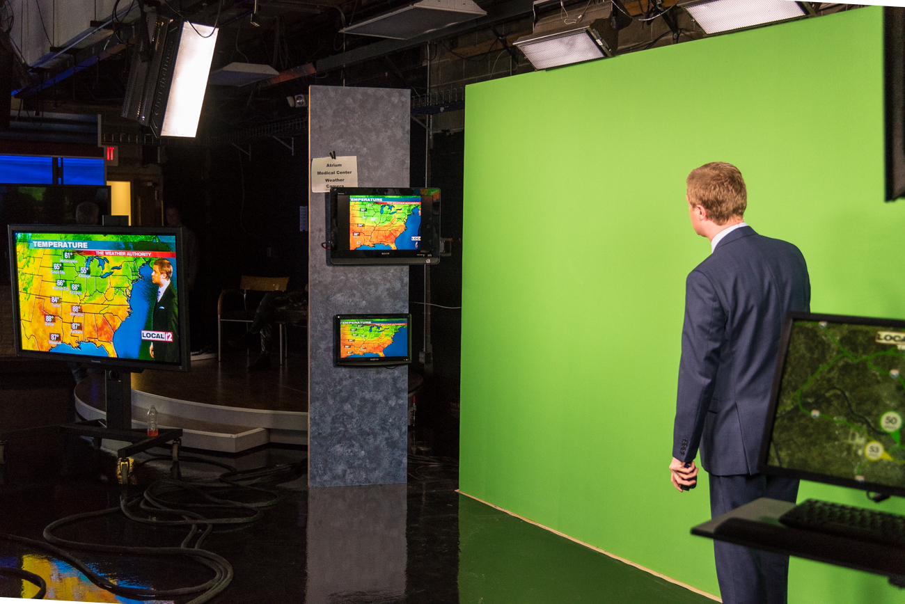 Meteorologist Scott Dimmich rocking the green screen /  Image: Phil Armstrong, Cincinnati Refined