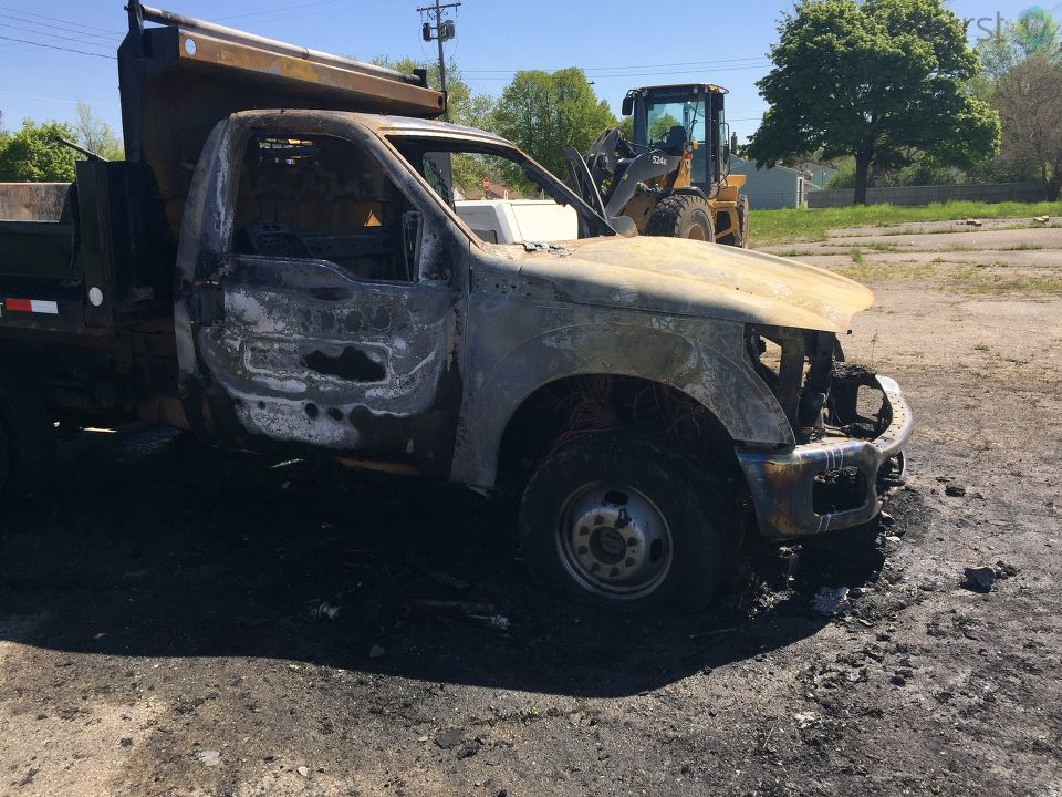 A truck and two pieces of heavy equipment were damaged overnight in Flint. (Photo Credit: Joel Feick)