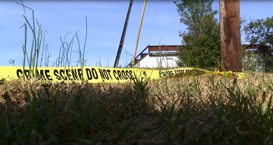 Crime scene tape around the scene where a teen was shot to death in Robeson County the morning of April 19, 2016. (Tonya Brown / WPDE)
