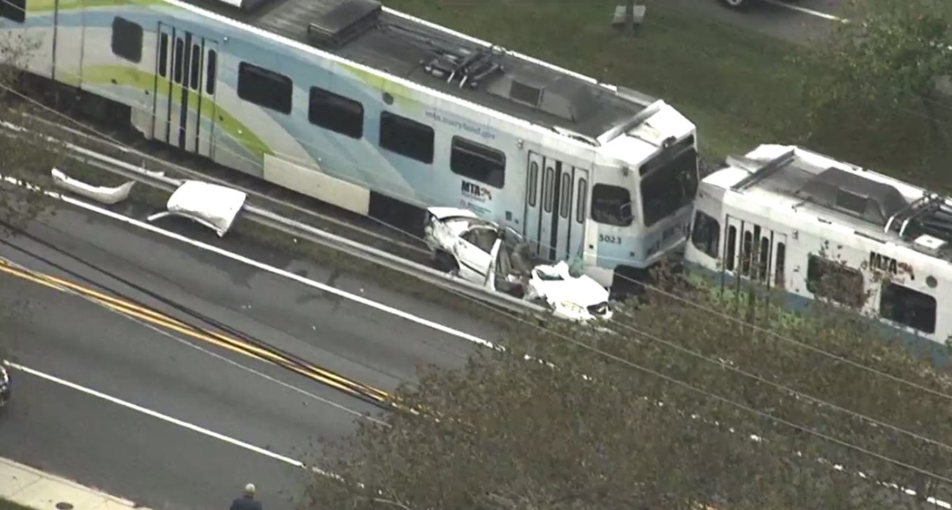 A woman and boy were injured after a car collided with a light rail train in Glen Burnie, Md.  Friday, Oct. 13, 2017 (SkyTrak7)