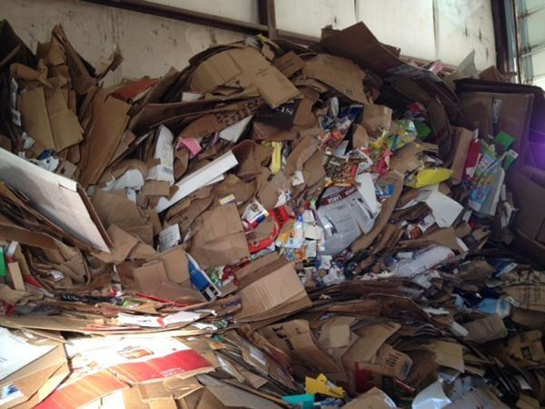 Workers at the OEMA recycling center found the album in a pile of cardboard