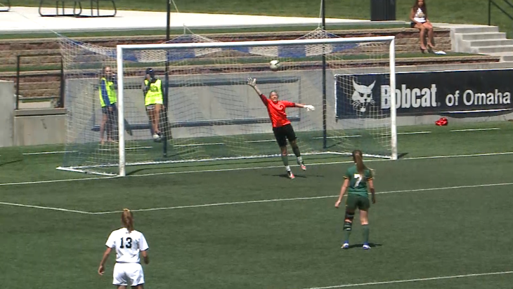 Jaedyn Bosshammer (red) leaps unsuccessfully to keep a shot out of the net for Kearney Catholic, May 12, 2017, at the Nebraska Class B state tournament (NTV News)