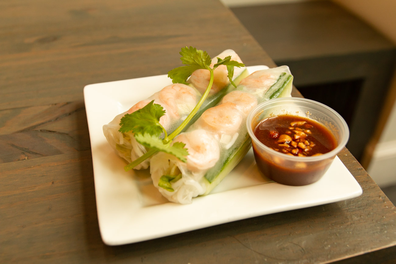 <p>Their fresh spring rolls consist of two rice wraps with vermicelli noodles, cilantro, cucumbers, and lettuce and served with a side of homemade peanut dipping sauce. You can choose from pork and shrimp or vegetarian rolls or fried option. / Image: Elizabeth A. Lowry // Published: 1.2.20</p>