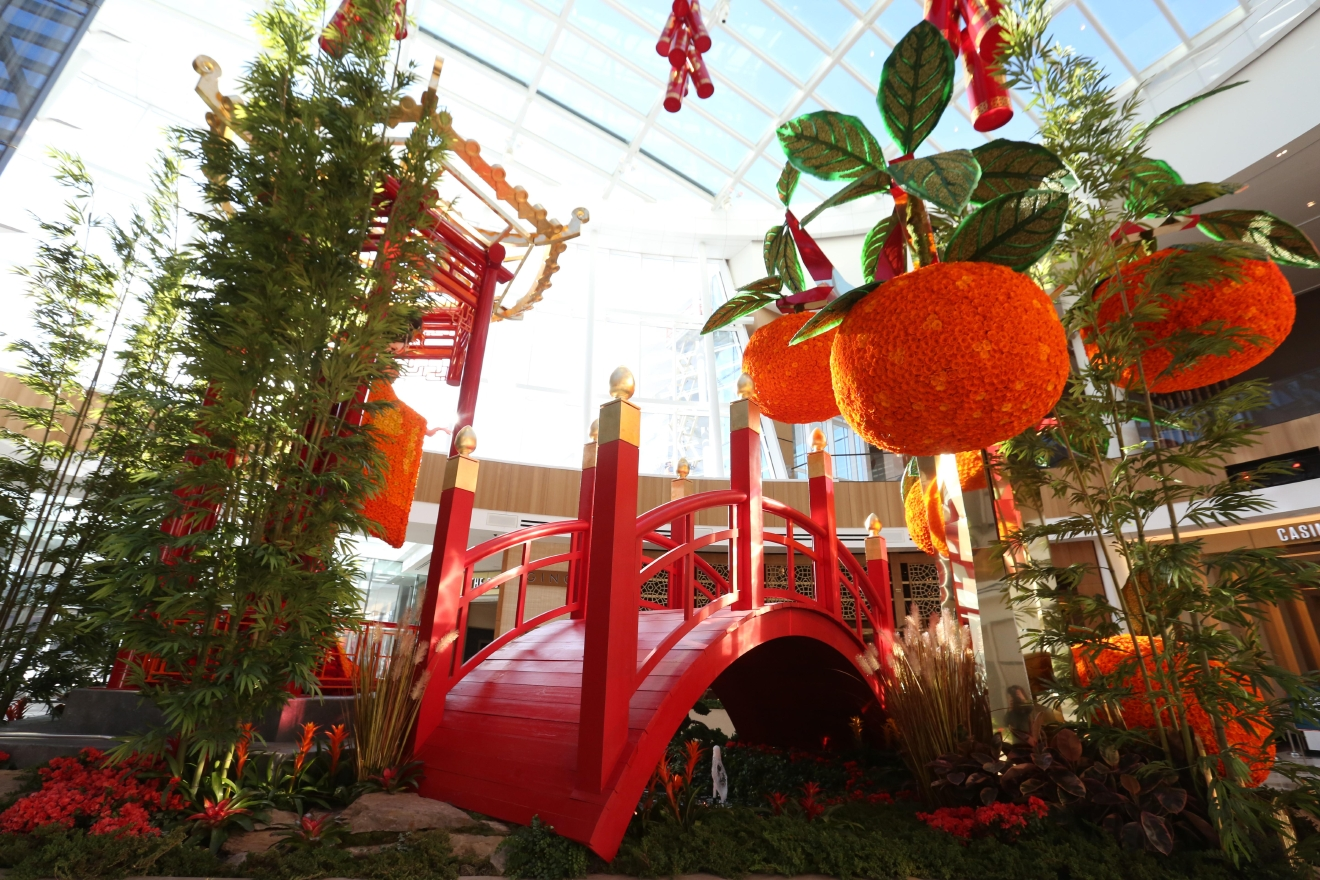 "According to Chinese tradition, 2017 is the year of the rooster - an occasion that MGM National Harbor decided to mark by creating a gorgeous floral display in its conservatory. According to the newly opened hotel and casino, the display includes an homage to ""Lady Luck,"" a traditional moon gate bridge and, of course, a 30-foot tall rooster. The fiery display required 200,000 flowers and will adorn the conservatory until March. (Amanda Andrade-Rhoades/DC Refined)"