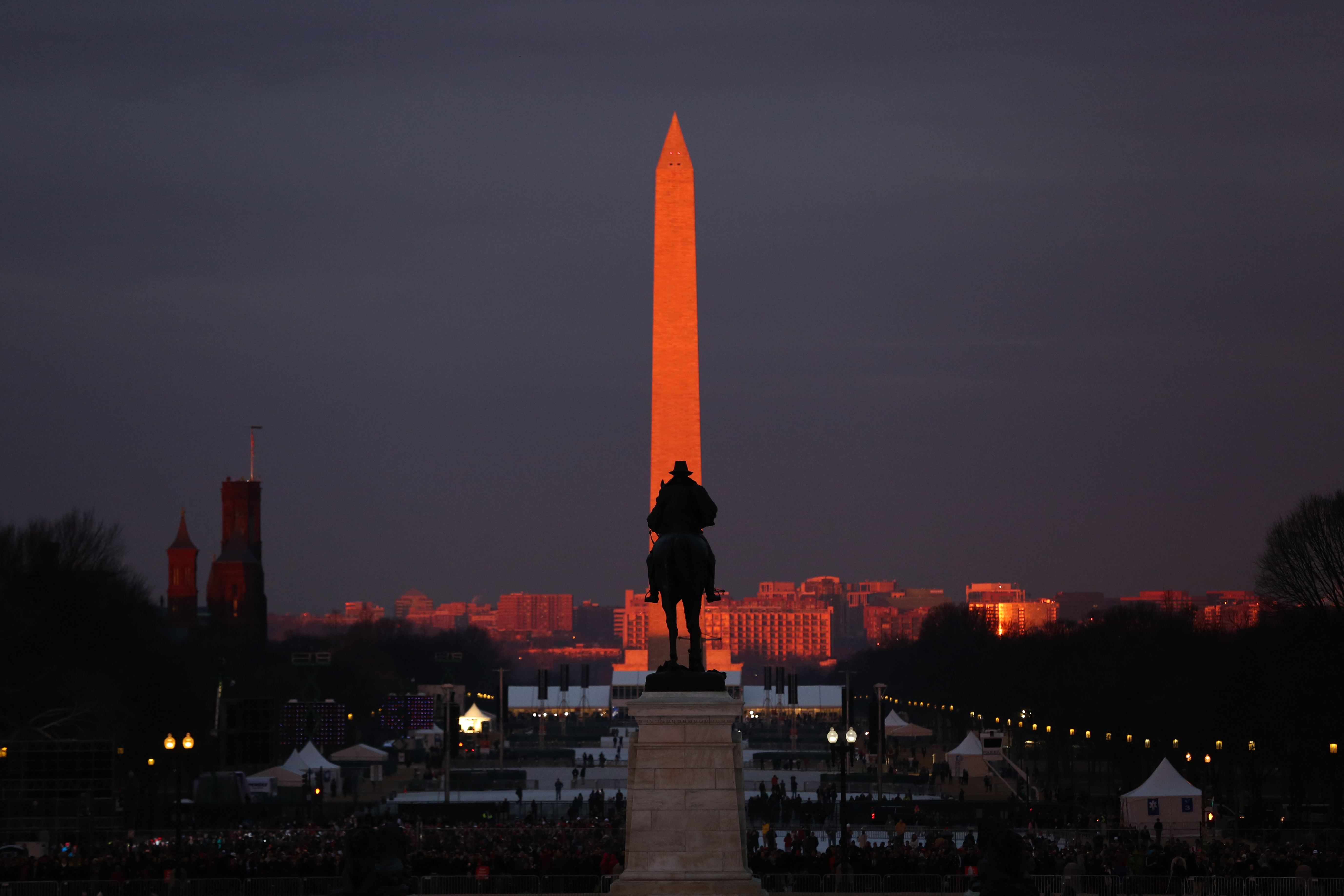 January, 2017. The Washington Monument glows red before the inauguration. (Amanda Andrade-Rhoades/DC Refined)<p></p>