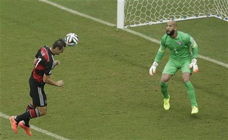 Germany's Miroslav Klose heads the ball towards the goal which goes wide past United States' goalkeeper Tim Howard during the group G World Cup soccer match between the USA and Germany at the Arena Pernambuco in Recife, Brazil, Thursday, June 26, 2014.