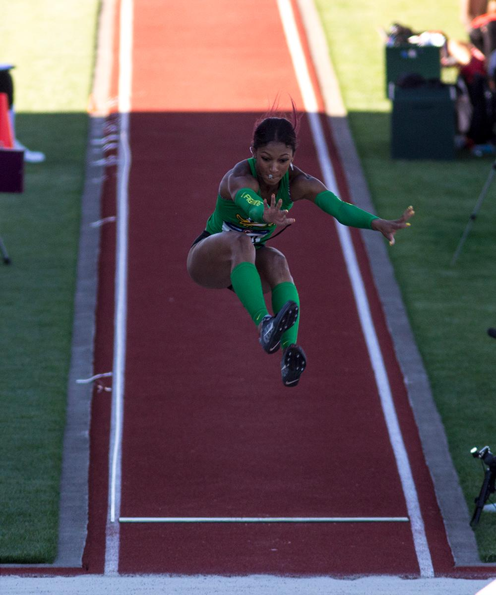 Jasmine Todd leaps into the sand pit while competing in the Women�s Long Jump. Todd placed 12th overall. Day one of the U.S. Olympic Trials began on Friday at Hayward Field in Eugene, Ore. And will continue through July 10. (Photo by Amanda Butt)