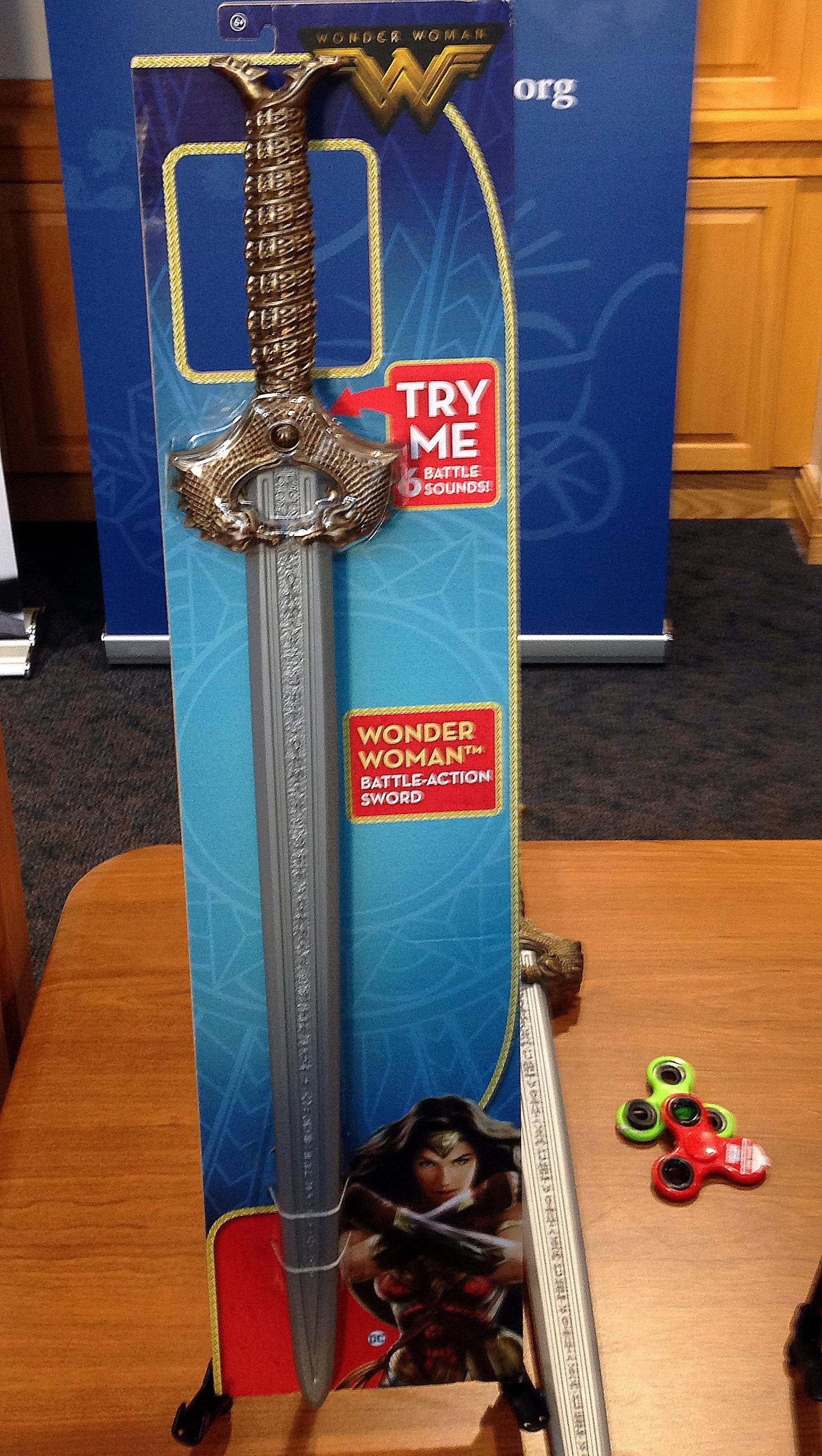 "A Wonder Woman ""battle sword"" is displayed during a news conference Tuesday, Nov. 14, 2017, in Boston, where the child safety group World Against Toys Causing Harm, or W.A.T.C.H., released its annual holiday list of the 10 most hazardous toys. (AP Photo/Philip Marcelo)"