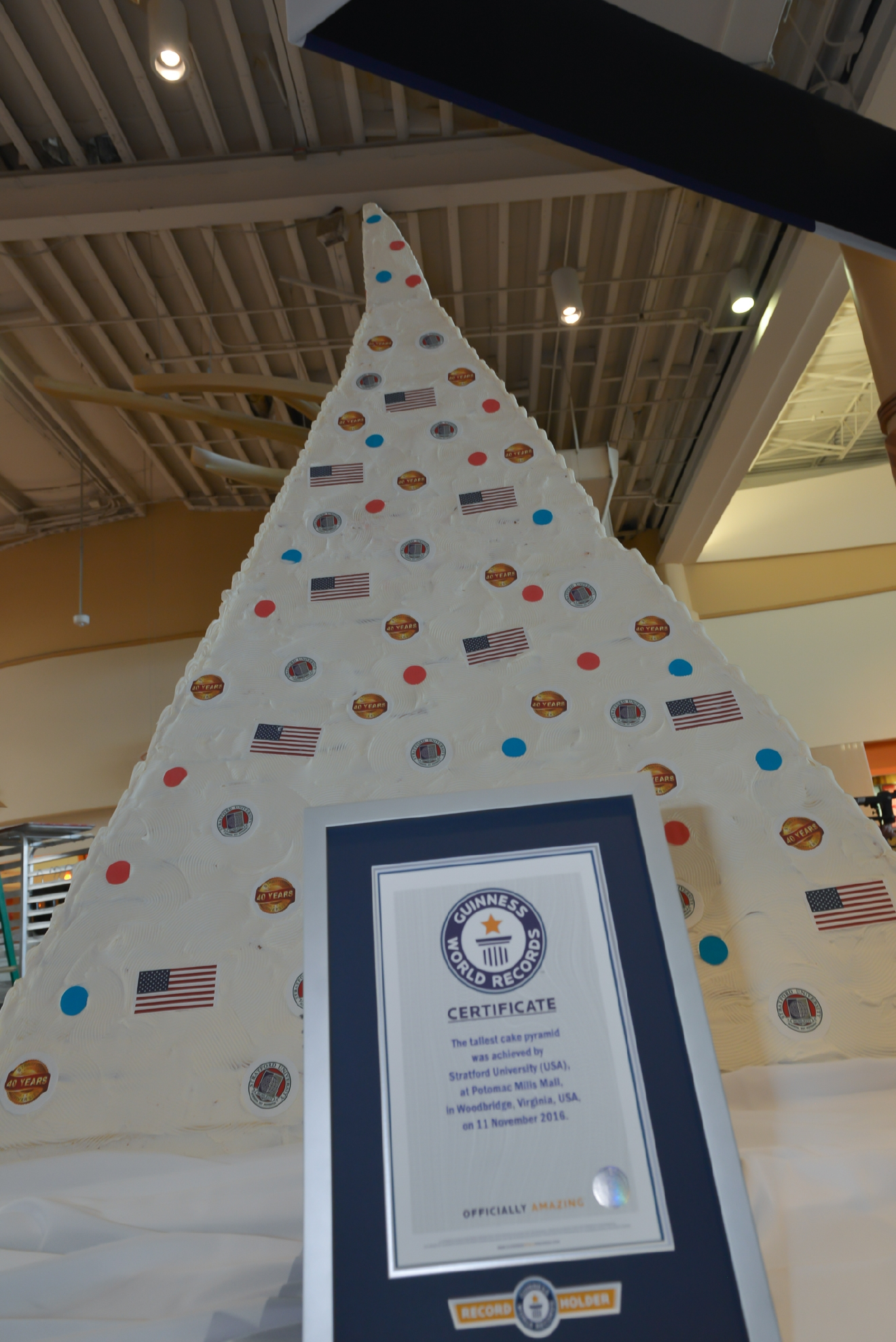 "The 9'2"" cake that is the world's current tallest pyramid cake, shattered the previous record of 6'5"" in India. (Image: Courtesy Stratford University)"