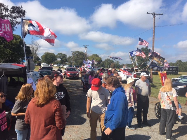 Oct. 27, 2020 - Hours ahead of Vice President Mike Pence's campaign stop in Greenville, S.C., supporters from all across the area gathered and parked in a grassy field, many setting up tents selling t-shirts, hats, flags and other Trump/Pence merchandise. (Photo credit: WLOS Staff)