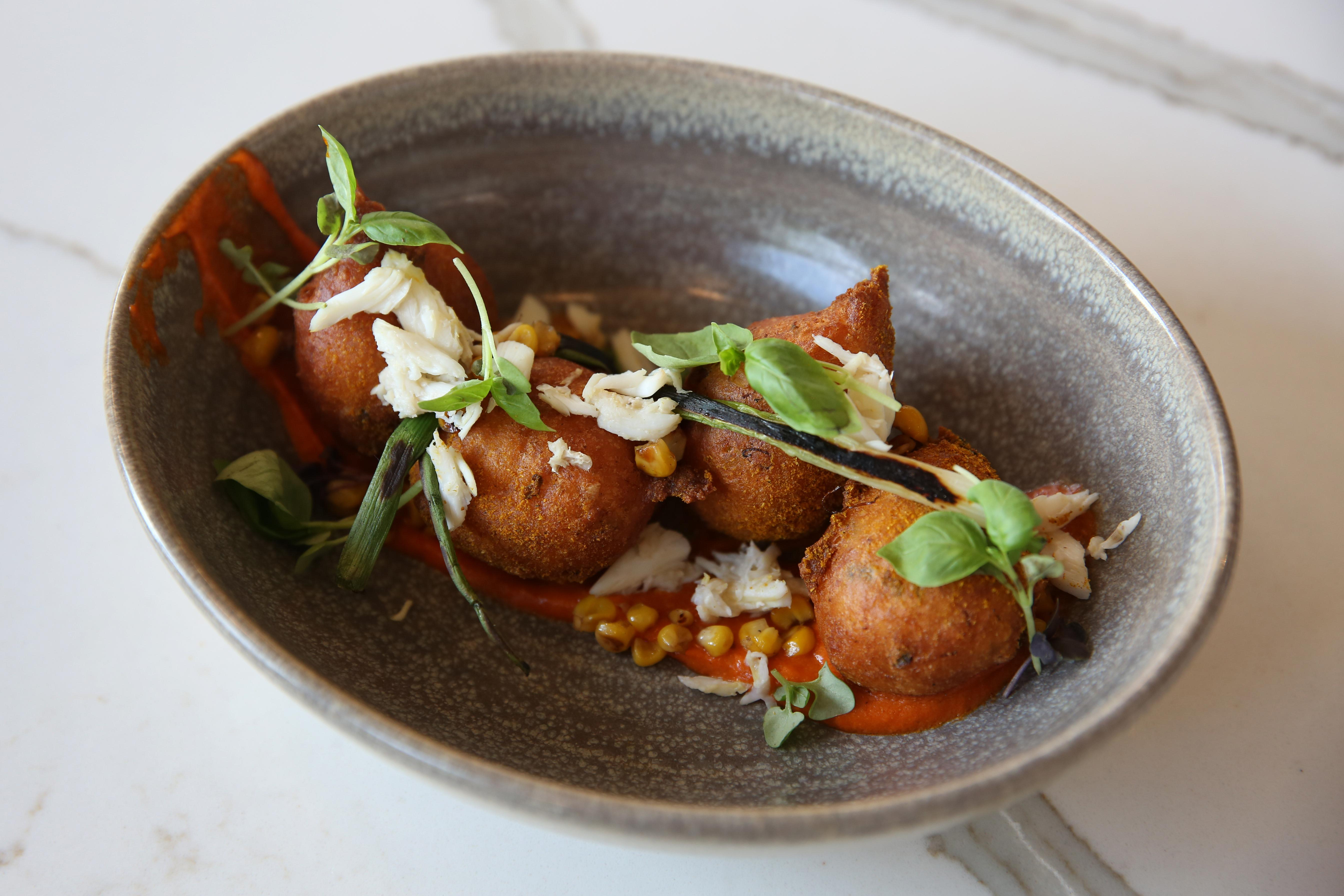 Dig into butternut squash muhammara dip, the restaurant's signature Maryland crab beignets or its unique pastrami-spiced salmon (lunch) or monkfish (dinner).{ }(Image: Amanda Andrade-Rhoades/ DC Refined)