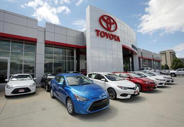 Toyota profit rises on sales growth, cheap yen, cost cuts