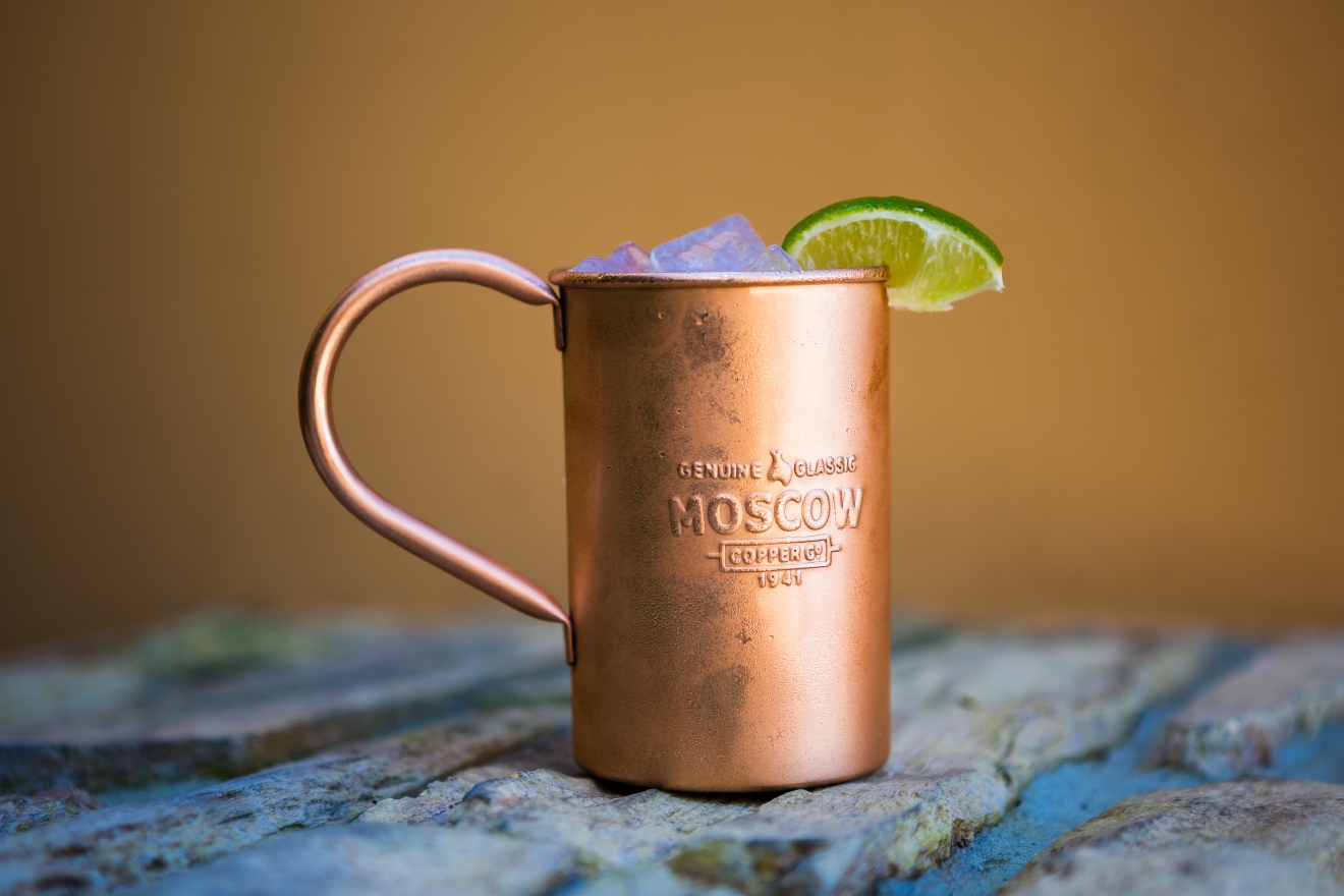 Why drink your MM in the original copper mug? It is a scientific fact that a chemical reaction takes place when the vodka and ginger beer hit the surface of the copper, which magnifies the carbonation and showcases the clear spirit. (Image: Courtesy  Moscow Copper Co)