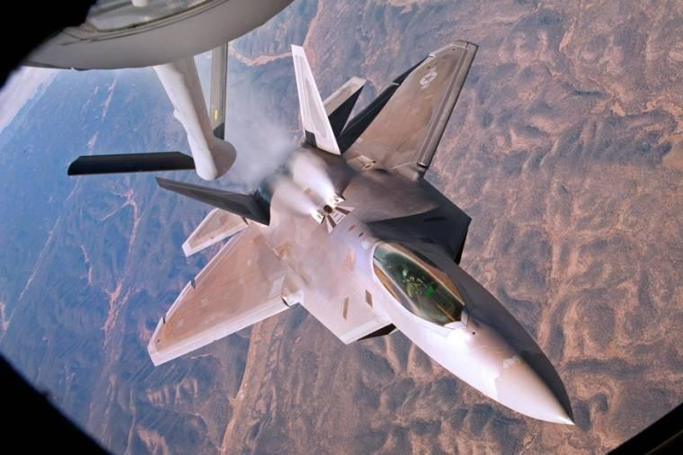 A U.S. Air Force F-22 Raptor backs away from a KC-135 Stratotanker aircraft during a refueling mission over New Mexico. The Raptor pilot is assigned to the 49th Fighter Wing and the Stratotanker is assigned to McConnell Air Force Base, Kan.