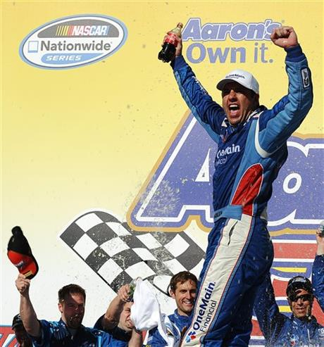 Elliott Sadler celebrates winning the NASCAR Aaron's 312 Nationwide series auto race at Talladega Superspeedway, Saturday, May 3, 2014, in Talladega, Ala.