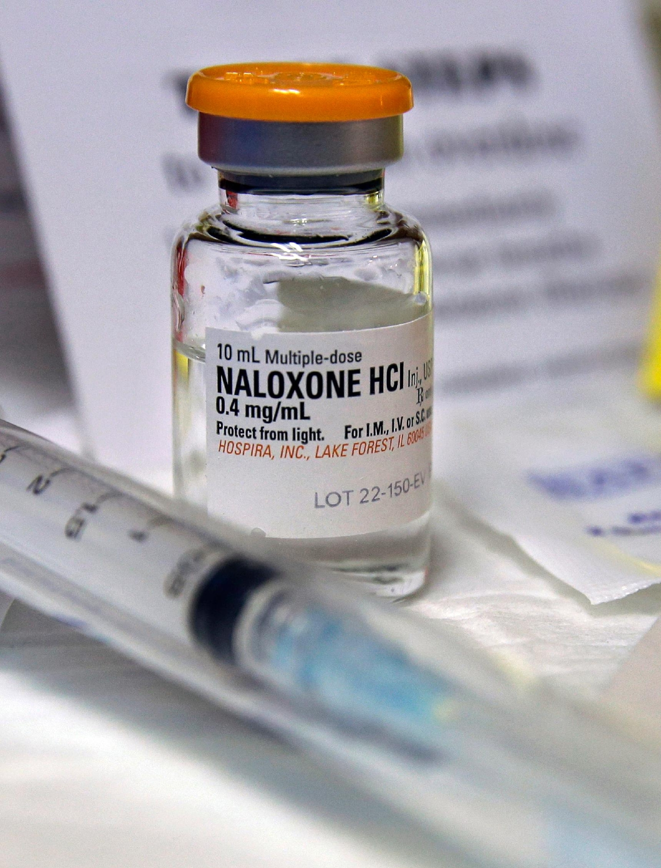 FILE- In this Wednesday, Feb. 19, 2014, file photograph, a small bottle of the opiate overdose treatment drug, naloxone, also known by its brand name Narcan, is displayed at the South Jersey AIDS Alliance in Atlantic City, N.J. It is becoming easier for friends and family of heroin users or patients abusing strong prescription painkillers to get access to naloxone, a powerful, life-saving antidote, as state lawmakers loosen restrictions on the medicine to fight a growing epidemic. (AP Photo/Mel Evans, File)