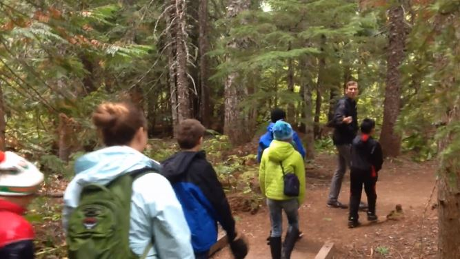 Kevin Frazier, second from right, leads a tour for kids near Mount Hood. (Passport Oregon)