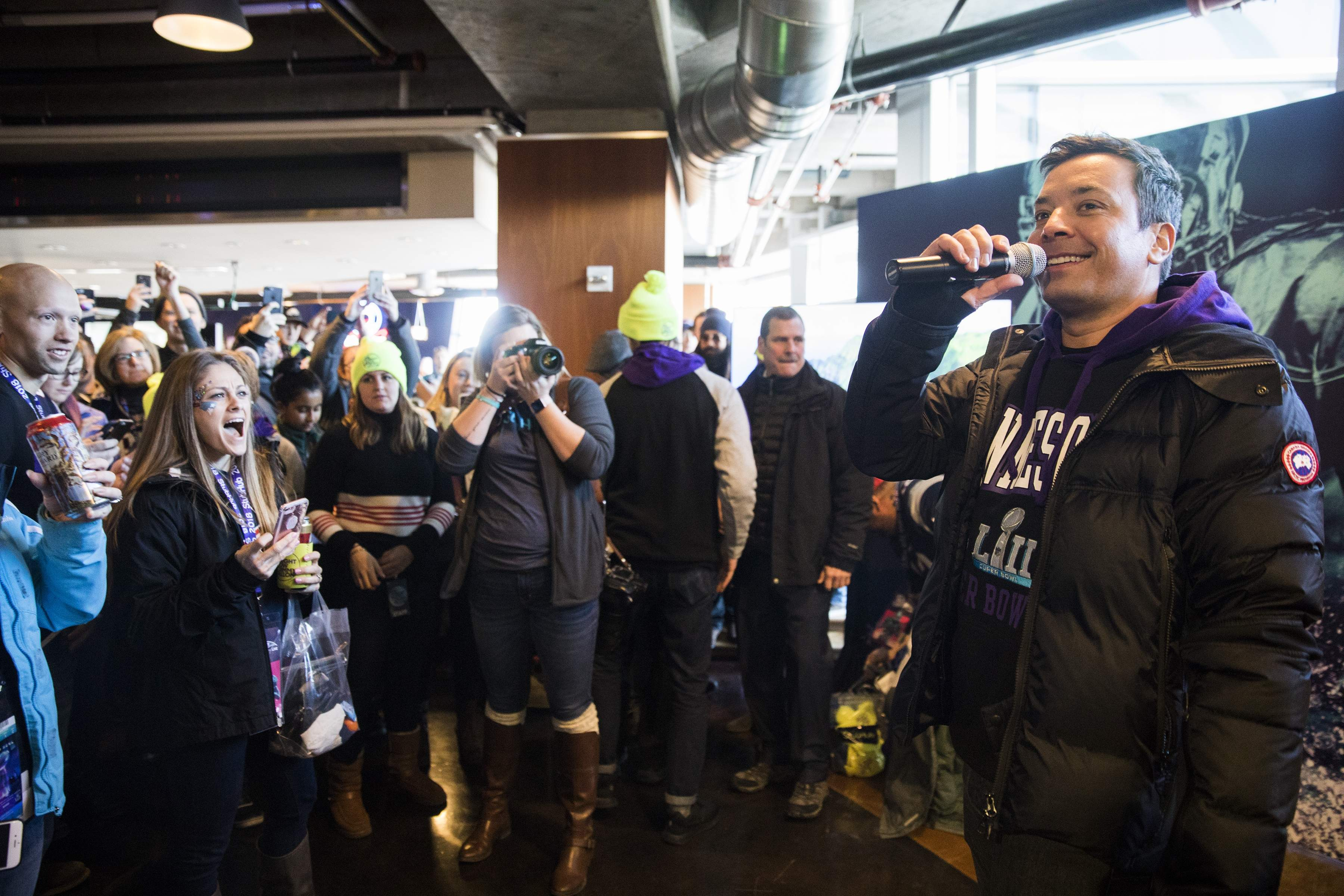 Jimmy Fallon appears with fans as he does some taping for 'The Tonight Show with Jimmy Fallon,' at The StubHub Live: Field House Super Bowl pregame event at Target Field, Sunday, Feb. 4, 2018 in Minneapolis. The event, free for those who purchased tickets to the Super Bowl on StubHub, included food and drink, tailgating games and meet and greets with football greats. (Leila Navidi/Star Tribune via AP)