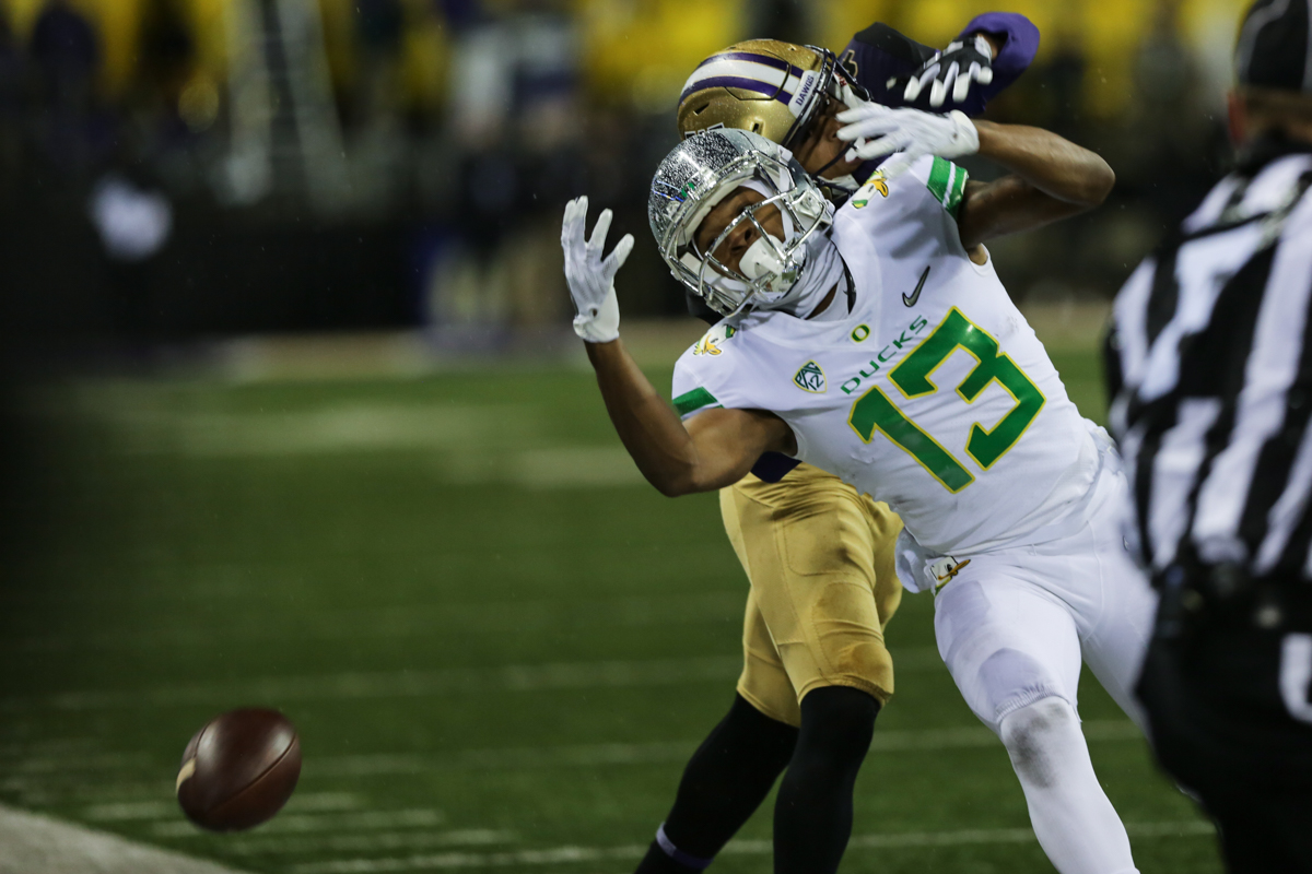 Oregon wide receiver Dillon Mitchell (#13) dives for an overthrown pass. The Oregon Ducks fell to the Washington Huskies 38 - 3 on a cold and rainy night in Seattle, Washington.  Oregon opened the game with a field goal on their first drive and was held scoreless from then on.  Photo by Austin Hicks, Oregon News Lab