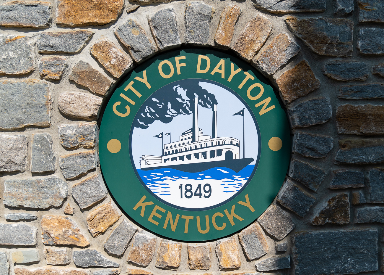 A City of Dayton medallion inlaid into the Manhattan Harbour sign on the flood wall's western end. / Image: Phil Armstrong // Published: 9.27.20