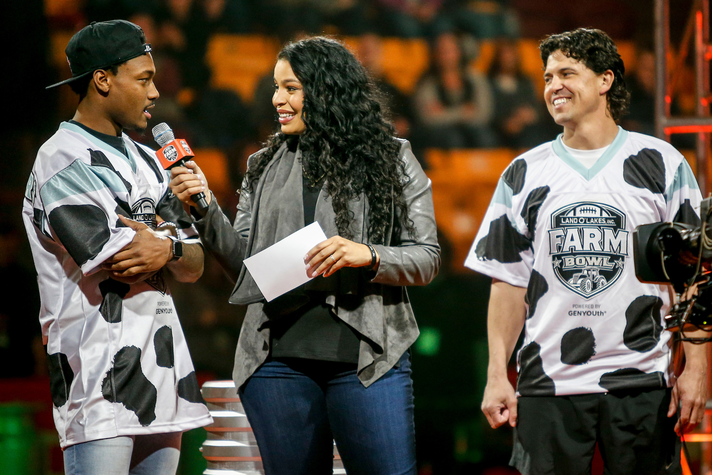 Jordin Sparks interviews Minnesota Vikings wide receiver Stefon Diggs and farmer JJ Nunes during the Land O'Lakes Farm Bowl on  Thursday, Feb. 1, 2018 in Minneapolis. (Bruce Kluckhohn/AP Images for Land O'Lakes)