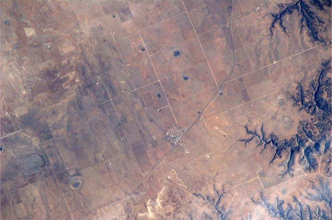 Hello Roy, NM. You may be small, but you can still be seen from space! (Photo & Caption: Mike Hopkins, NASA)