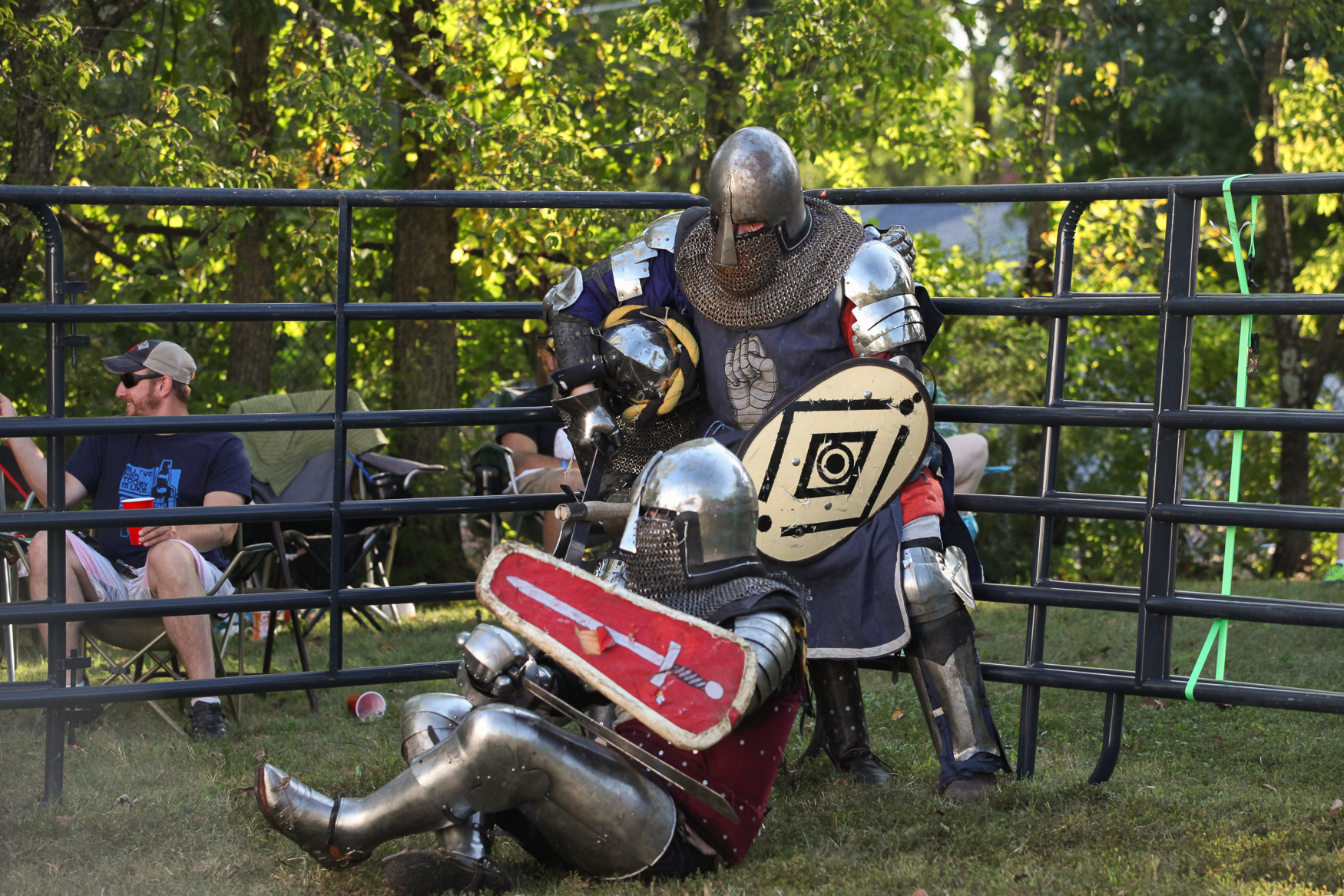 You make think that fighting in suits of armor is reserved for extremely enthusiastic Renn faire-goers or extras on Game of Thrones. However, if you happened to stop by the Fort Drive Community Center in Alexandria, VA, on Saturday, September 29, you might have been forced to change your opinion. Over a dozen men and women from D.C., Maryland, North Carolina and Pennsylvania were battling each other in suits of armor. Those men and women belong to the Armored Combat League, a national organization which gives participants the chance to competitively fight each other with medieval weaponry. The sport isn't without risk - the training is intense and the injuries are frequent. However, all the competitors say they wouldn't change it for anything. (Amanda Andrade-Rhoades/DC Refined)