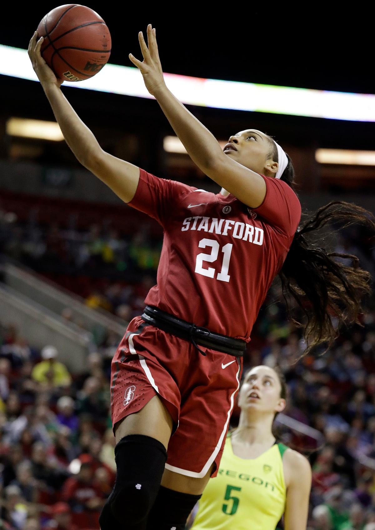Stanford's Dijonai Carrington shoots past Oregon's Maite Cazorla during the first half of an NCAA college basketball game in the finals of the Pac-12 Conference women's tournament, Sunday, March 4, 2018, in Seattle. (AP Photo/Elaine Thompson)