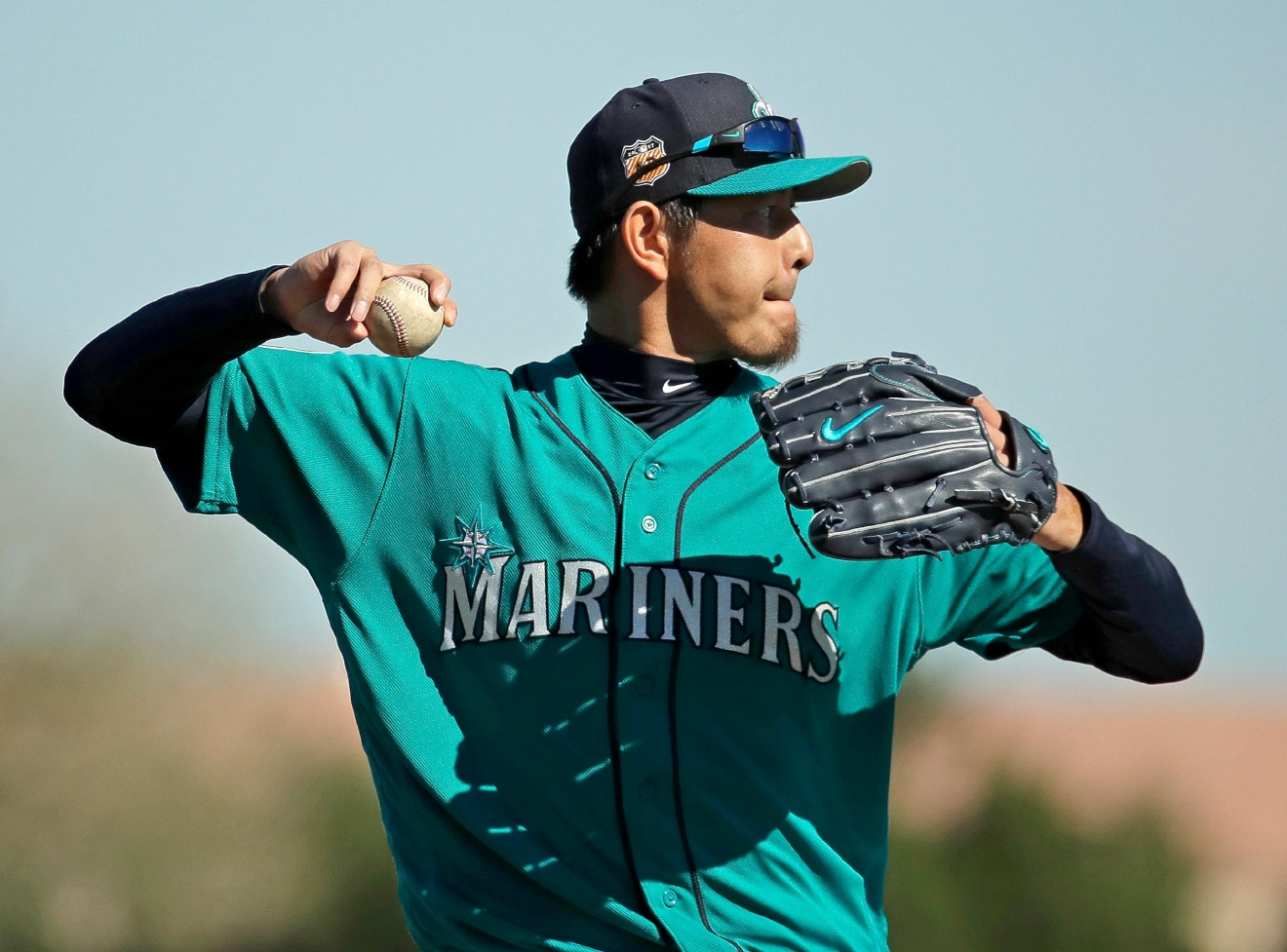 Seattle Mariners pitcher Hisashi Iwakuma throws during spring training baseball practice, Tuesday, Feb. 21, 2017, in Peoria, Ariz. (AP Photo/Charlie Riedel)